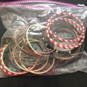 Bag of misc bangles and bracelets